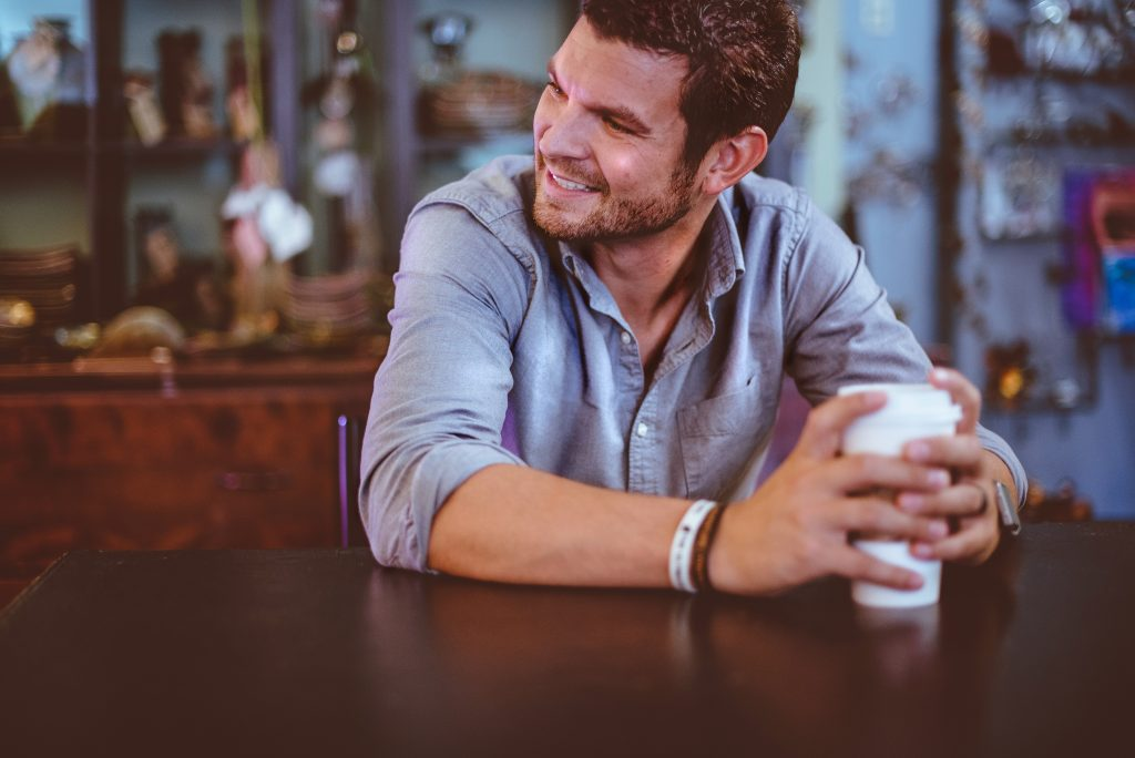 Smiling Man hanging out happy with Coffee